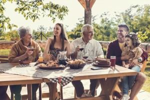 stock-photo-67178421-cheerful-multi-generation-family-having-lunch-on-restaurant-terrace